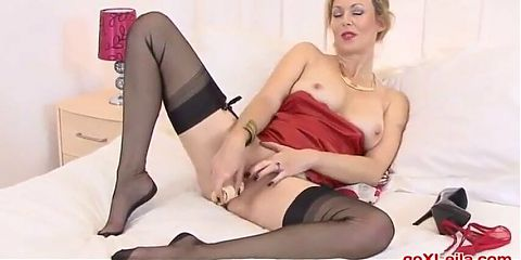 Betsy Blue masturbates in a red leather outfit.